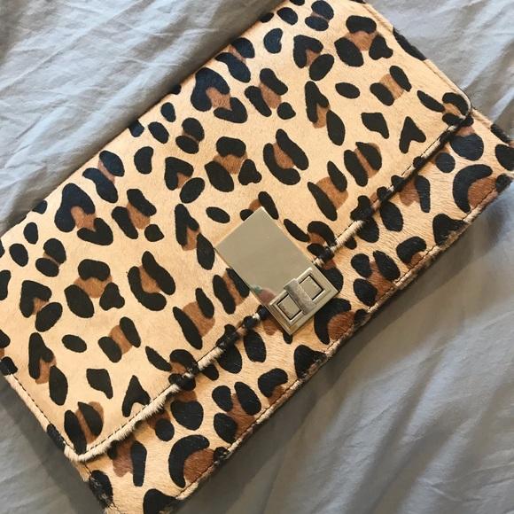 a05c08028b29 Express Handbags - Large Calf Hair Leopard Clutch by Express